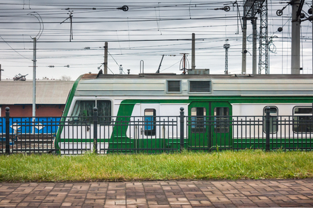 Suburban electric train at the railway station Фото со стока