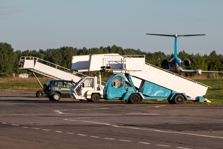 Aircraft boarding ramps at the airport apron Фото со стока