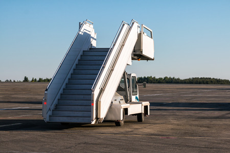 Passenger boarding stairs at the airport apron