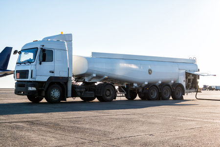 White tank truck aircraft refueler at the airport apron