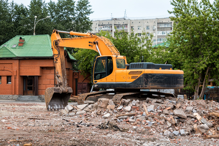 Crawler excavator at the site of the destroyed building Stock Photo