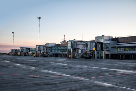 Empty jet bridges at the early morning airport apron