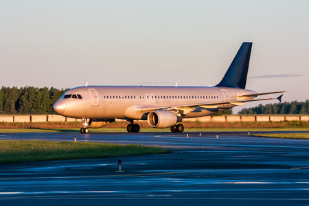 Taxiing passenger aircraft at the early morning Фото со стока - 98805925