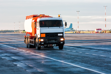 Tank truck aircraft refueler at the airport apron Фото со стока - 98909786
