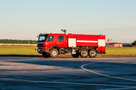 Red airfield fire truck at the airport