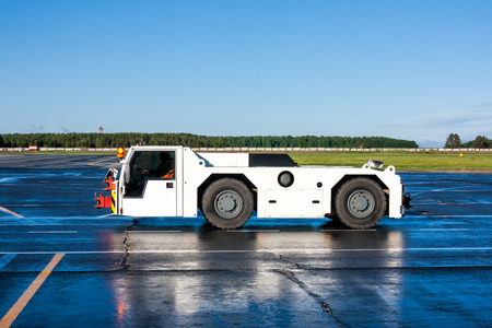 Aircraft tow truck at the airport apron