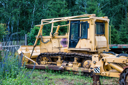 Yellow bulldozer in the forest