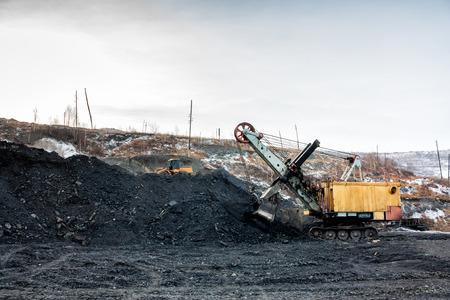 Crawler excavator in a coal mine