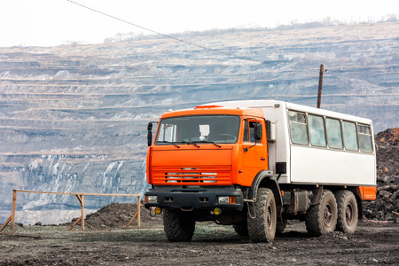 Crew bus in a quarry Фото со стока