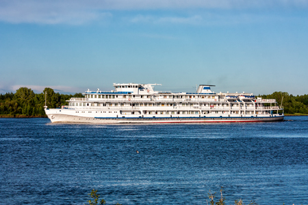 Passenger cruise ship sails on the river