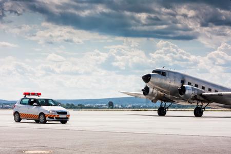Retro airplane moving to follow me car Фото со стока