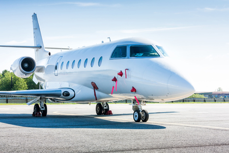 White private business jet at the parking lot of airport Standard-Bild