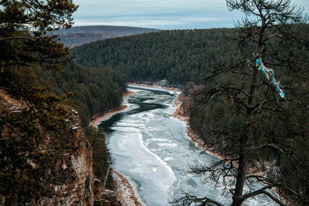 River and rocky coast in the taiga in winter