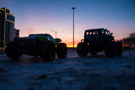 RC car monster trucks at sunset of the day Фото со стока