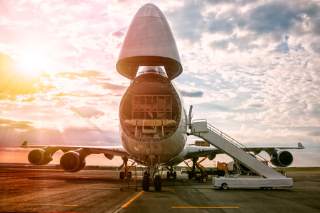 Unloading wide body transport cargo aircraft in the morning sun Фото со стока - 104791713