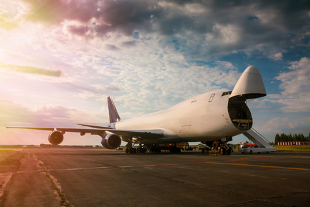 Unloading wide body transport cargo airplane in the morning sun Фото со стока - 104791727