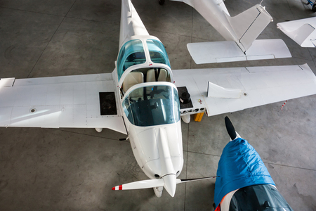 Top view of small sports airplanes in a hangar Фото со стока