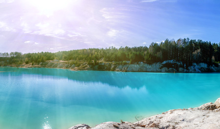 Scenic flooded clay quarry with turquoise water in the morning sun Фото со стока - 106567112