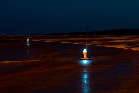 Taxiway, side row lights at the night airport Фото со стока
