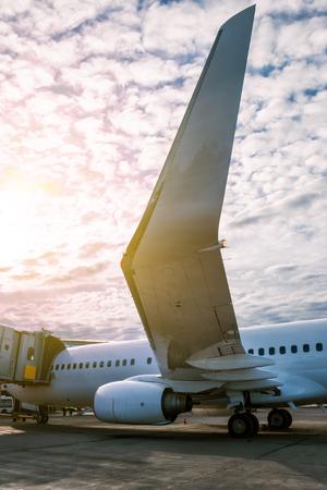 White passenger aircraft parked to a jetway Фото со стока