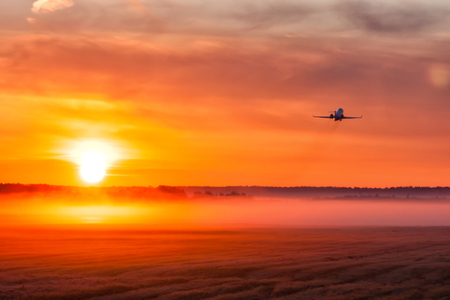 Picturesque dawn with a fog at the airport. Takeoff of a private jet
