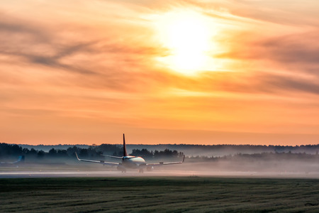 Picturesque dawn with a fog at the airport. Passenger aircraft on the runway Фото со стока - 109390462