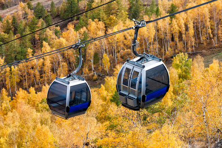 Cable car to the mountain in the autumn forest