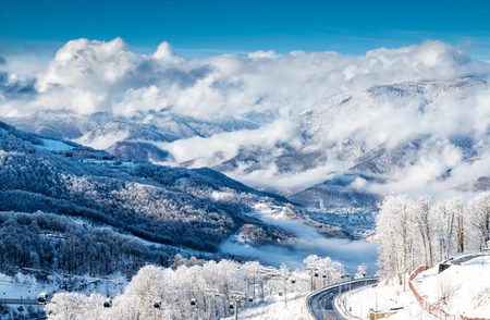 Scenic view of the snow-capped mountains in the clouds