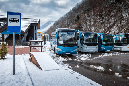 Bus station near the mountain forest at winter Фото со стока