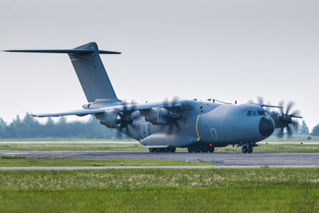 Heavy military transport turboprop taxiing Фото со стока