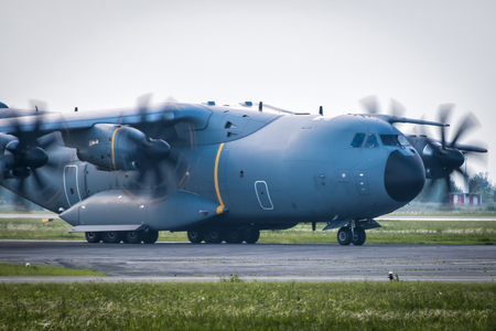 Close-up taxiing of heavy military transport turboprop aircraft