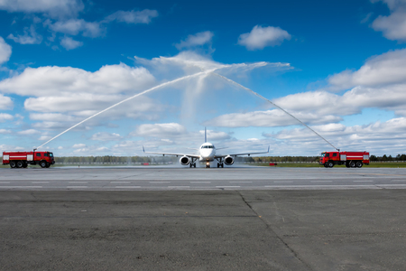 Water salute by fire truck at the airport for first visit passenger airplane
