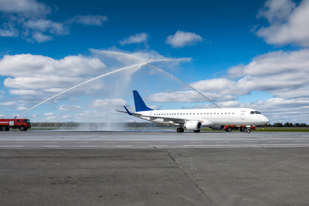 Water salute by fire truck at the airport for first visit passenger aircraft