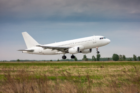 White passenger jet plane in the air on take-off