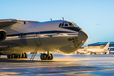 Close-up big cargo airplane at the airport apron in the early morning Фото со стока