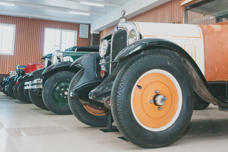 A line of classic retro cars of the early XX century
