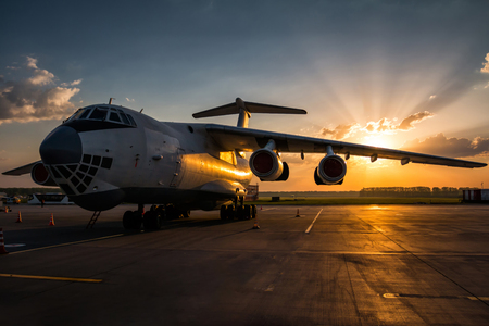 Wide body transport cargo airplane at airport apron in the morning sun