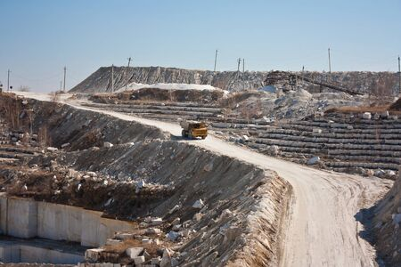 Marble quarry. A dumper rides in a career