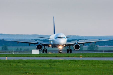 U-turn of a passenger jet plane on the runway. Front view