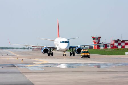 The passenger aircraft moves behind the Follow-me-Car