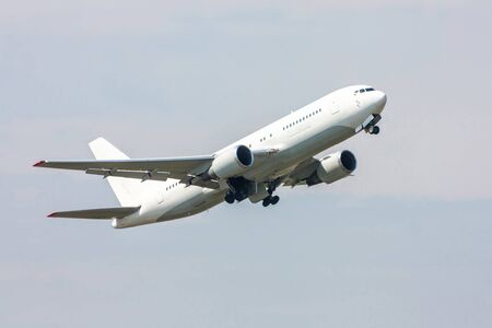 Take-off of a white passenger wide-body aircraft