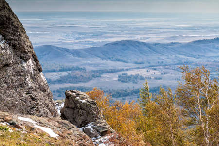 Rock, mountains and autumn forest