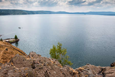 The rocky shore of a picturesque lake