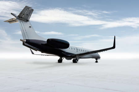 Modern corporate business jet isolated on light background with sky 版權商用圖片