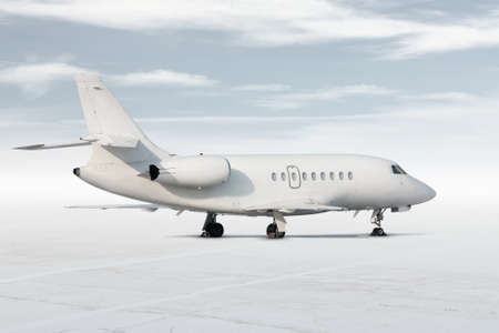 Modern white corporate business jet isolated on light background with sky 版權商用圖片