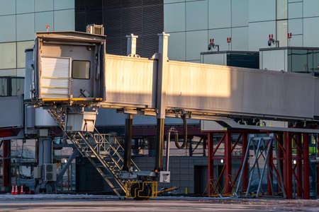Empty passenger boarding bridge at airport apron 版權商用圖片