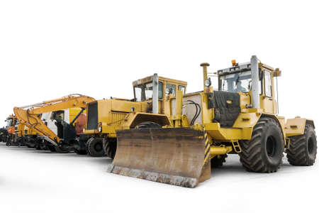 Two heavy wheeled tractor one excavator and other construction machinery isolated on white background Фото со стока