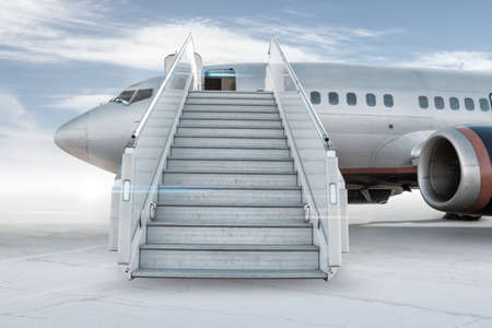 Passenger airplane with a boarding stairs on the airport apron isolated on bright background with sky Фото со стока