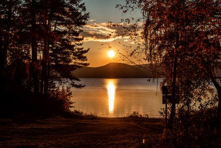 Scenic sunset on a beautiful lake in autumn Фото со стока