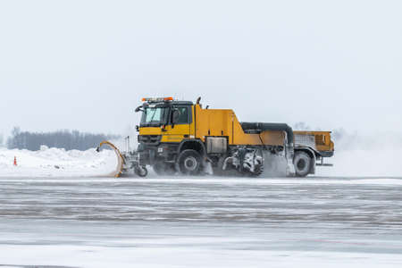 Snowblower cleans airport apron in a snowstorm